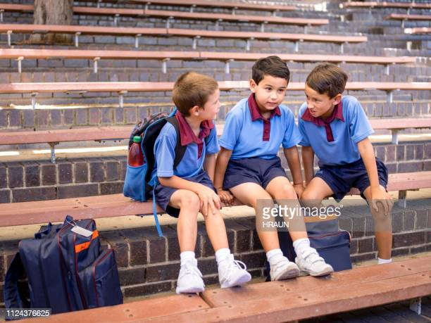 Boy talking with his classmates on steps