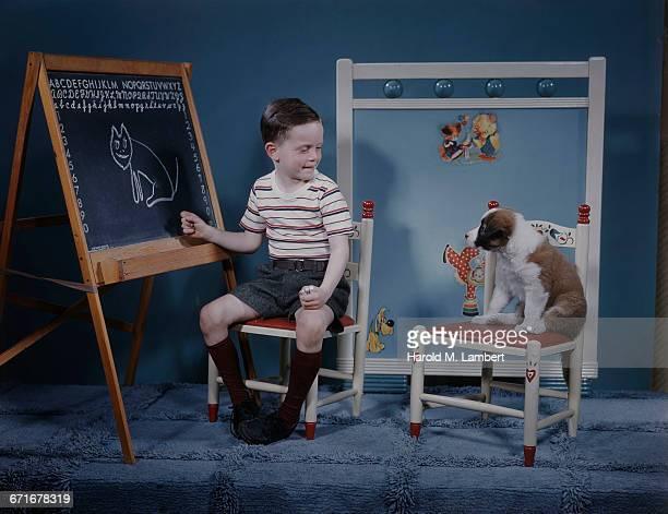 Boy Teaching Puppy