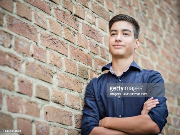 Boy, teenager, 14 years, leaning against a wall, portrait, Germany