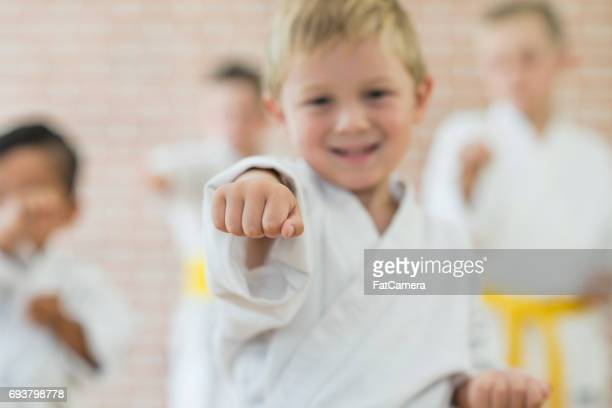 Boy Throwing a Punch at Martial Arts Practice
