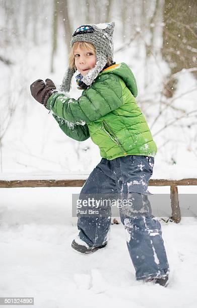 Boy throwing a snowball