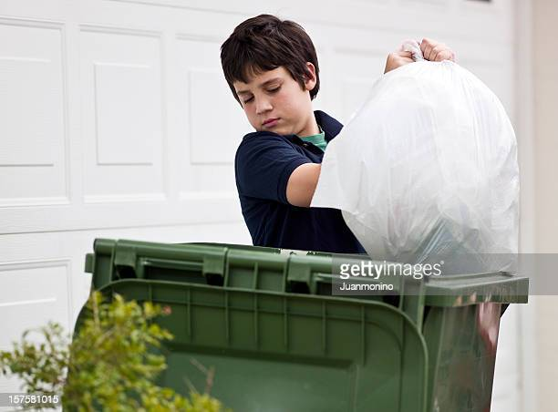boy throwing out the garbage - garbage can stock photos and pictures