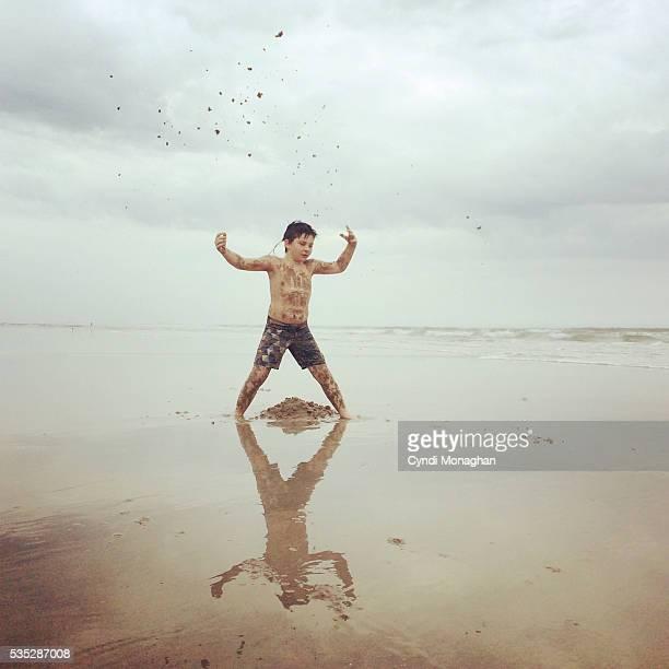 Boy Throwing Sand