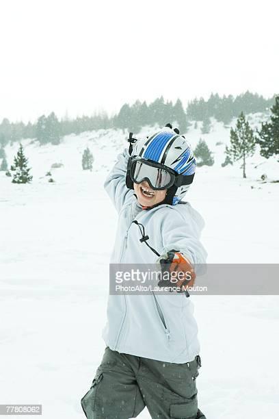 boy throwing snowball, dressed in ski clothing, three quarter length - three quarter length ストックフォトと画像