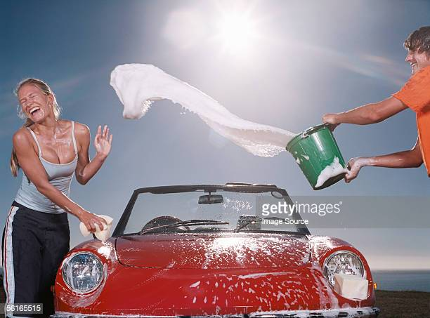 Boy throwing soapy water at girl