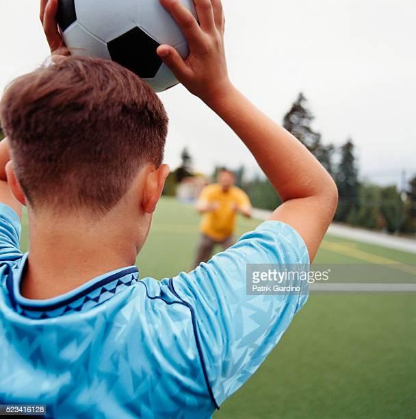 Boy Throwing Soccer Ball