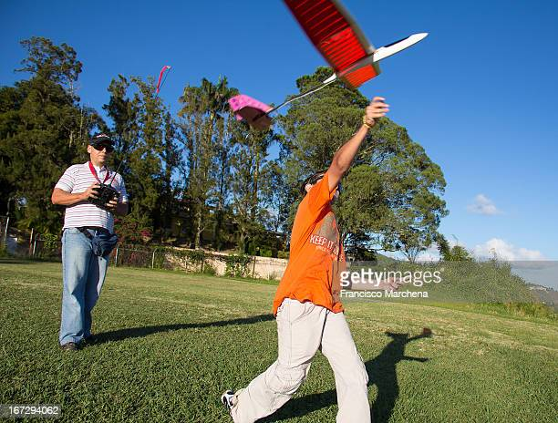 CONTENT] A boy throws a small radio controlled glider in an aero modeling club located near Caracas