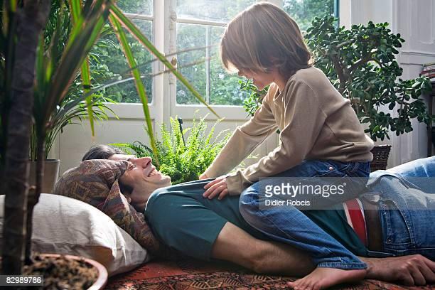 boy tickles dad