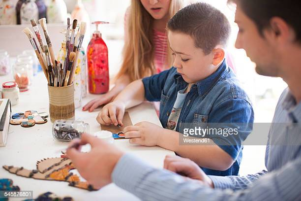 Boy tinkering in art class