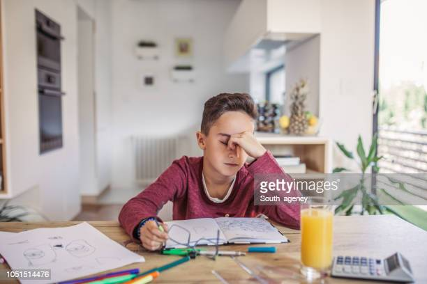 boy tired of doing math - exhaustion stock pictures, royalty-free photos & images