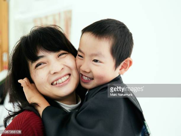 boy to the hozuri to favorite mom - forever young stock pictures, royalty-free photos & images