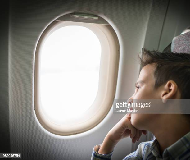Boy traveling by airplane