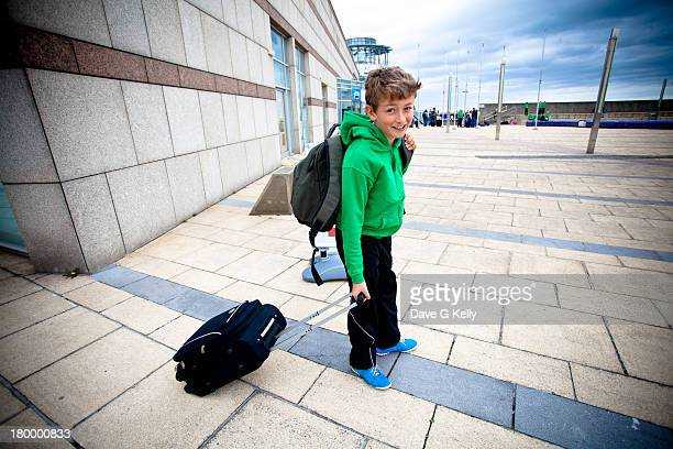 Boy Travelling with Suitcase