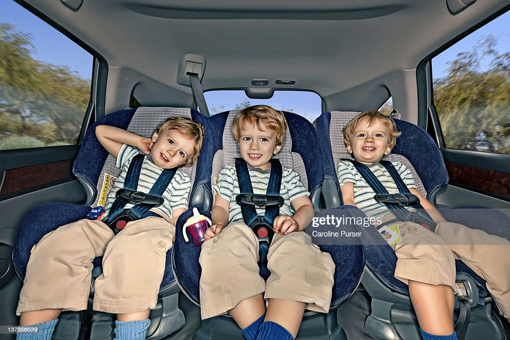 Boy Triplets In The Back Of A Car
