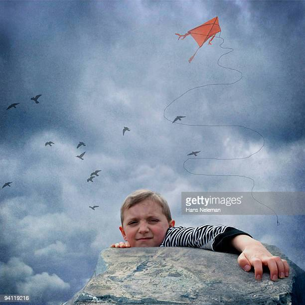 Boy trying to climb on a cliff, Dublin, Republic of Ireland