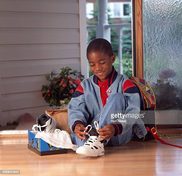 Boy tying his new shoe