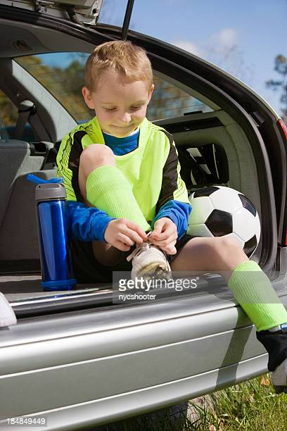 boy tying his soccer cleat