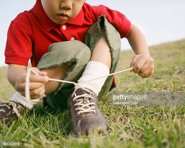Boy Tying Shoelace