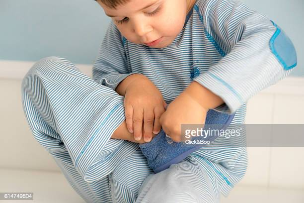 Boy tying the laces