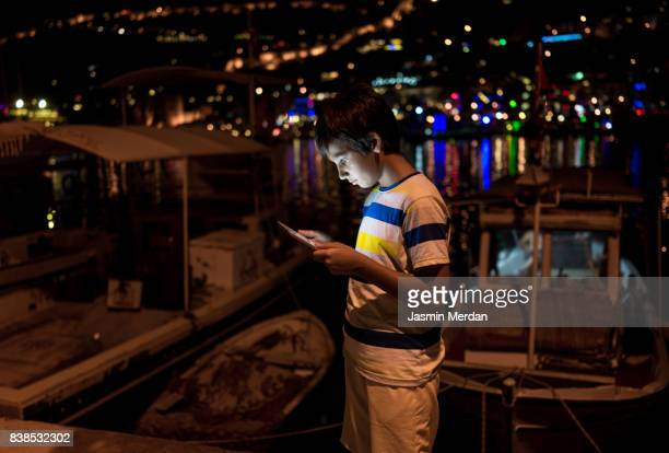 Boy typing on phone during vacation