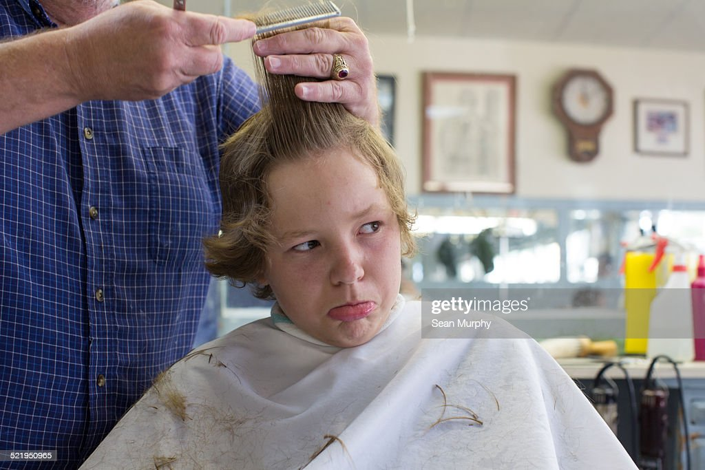 Boy Unahppy About Getting a Haircut : Stock Photo