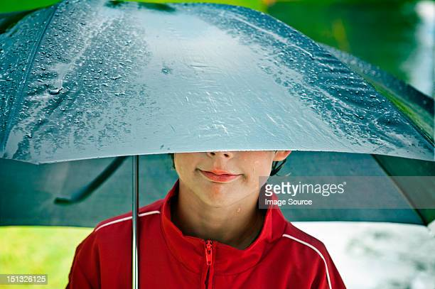 Boy under an umbrella
