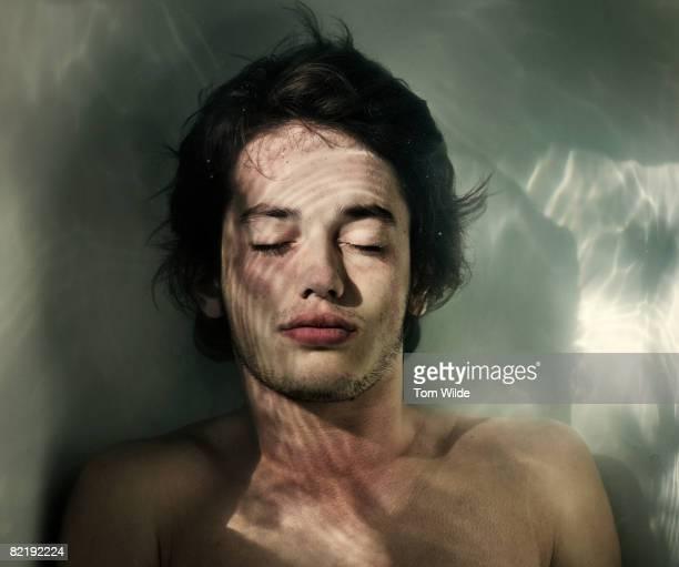 Boy under water in a bath