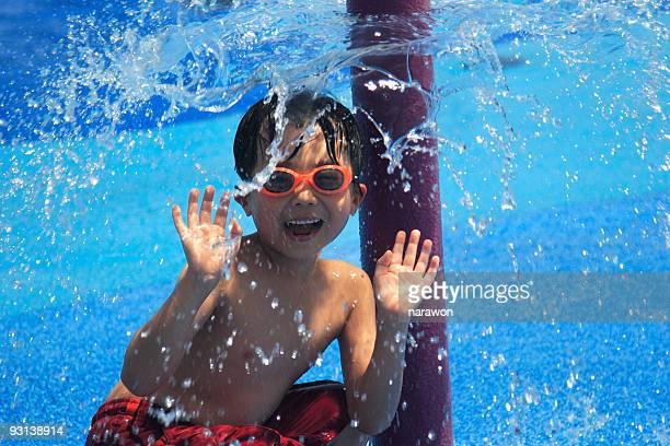 Boy under water spray