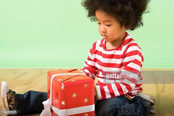 Boy unwrapping present