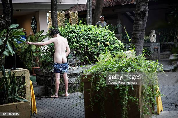 boy urinates intro flower pot in the hotel's garden during Australian 'schoolies' celebrations following the end of the year 12 exams on November 24...