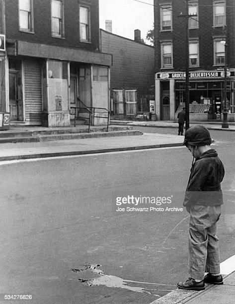 Boy Urinating in Brooklyn Street