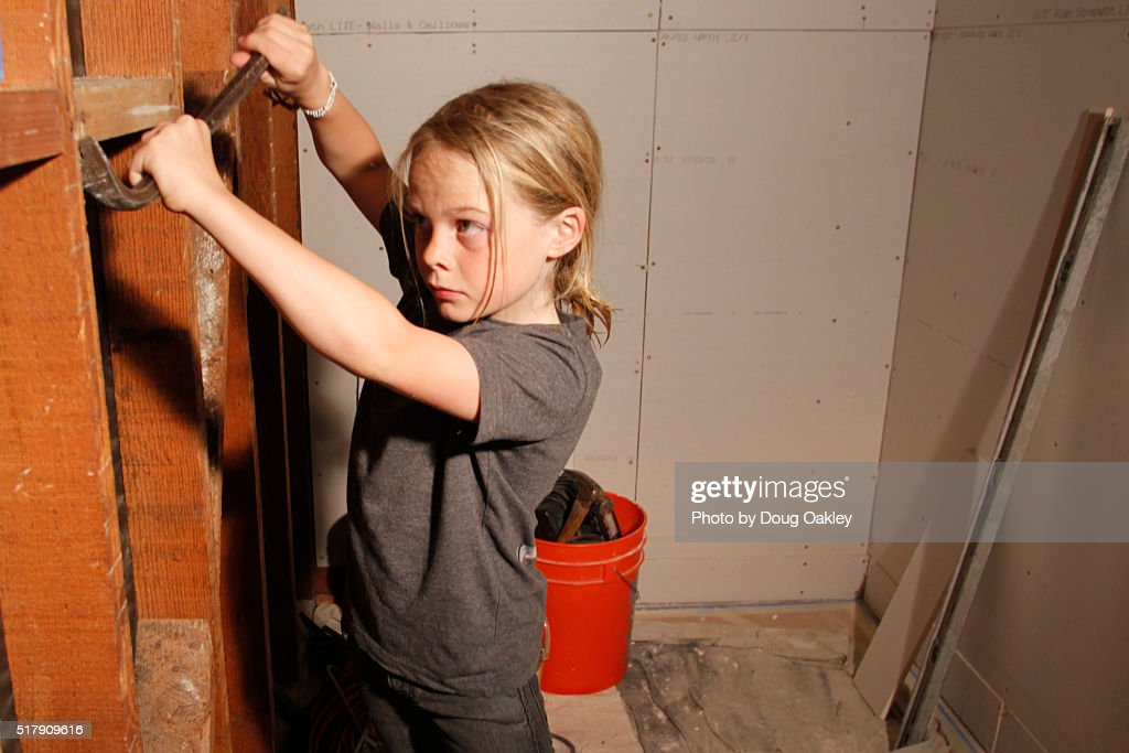 Boy uses crowbar in home doityourself home improvement project stock boy uses crowbar in home do it yourself home improvement project stock photo solutioingenieria Images