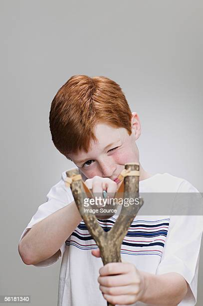 Boy using a catapult
