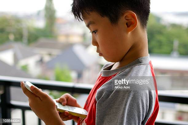 A boy using a cell phone
