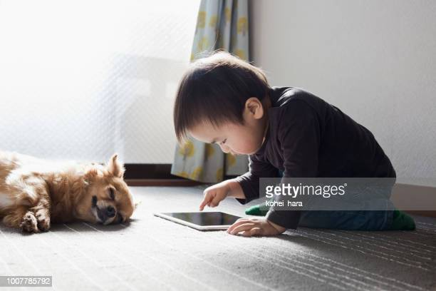 boy using a digital tablet - digital native stock pictures, royalty-free photos & images