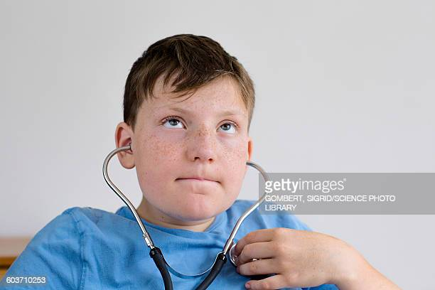 boy using a stethoscope - sigrid gombert stock pictures, royalty-free photos & images