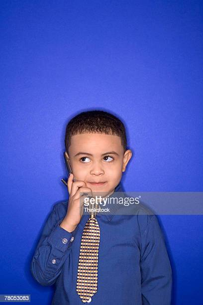 boy using cell phone - adult imitation stock pictures, royalty-free photos & images