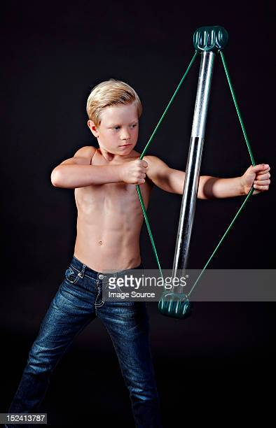 Boy using chest expander