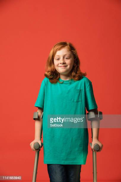boy using crutches - crutches stock photos and pictures
