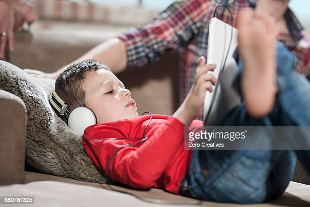 Boy using digital tablet at home