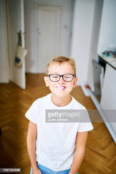 boy using lip sticker covering his own lips smiling surrealism - novelty item stock pictures, royalty-free photos & images