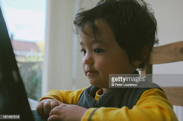 boy using modern technology - peter lourenco ストックフォトと画像