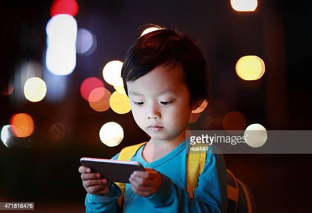 Boy Using Smart Phone in the night