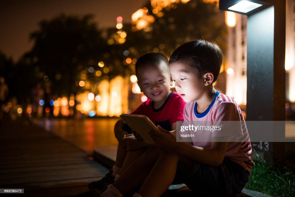 Boy Using tablet PC : Stock Photo