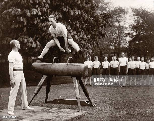 A boy vaults a horse during an outside gym class 1933 Gym classes were part of the educational curriculum for boys 1417 employed at Rowntrees and...