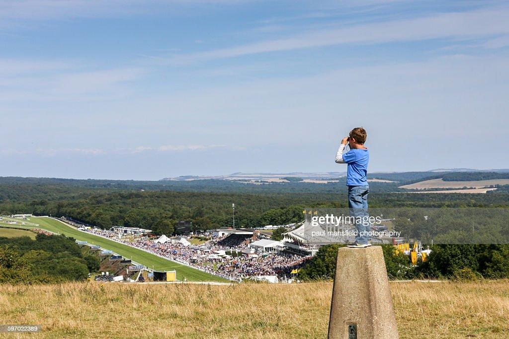 Boy viewing Goodwood racecourse : Stock Photo
