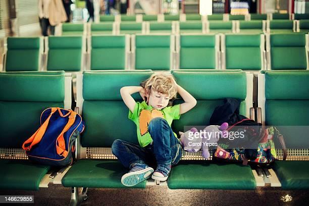 Boy waiting at airport