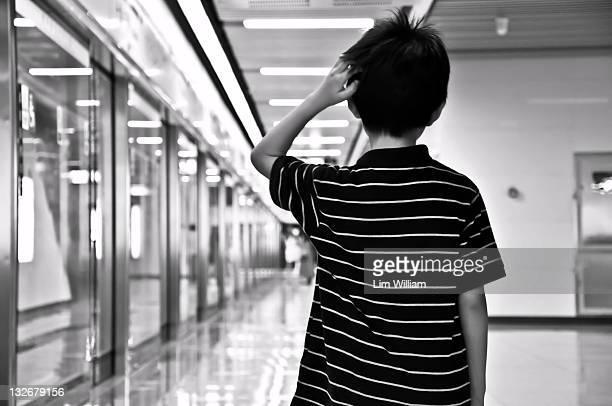 Boy waiting at train station