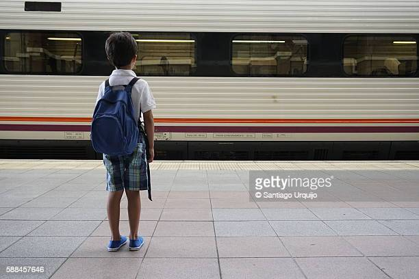 Boy waiting for his train