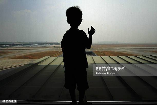 A boy waits for his family members arrival at Kuala Lumpur International Airport on March 12 2014 in Kuala Lumpur Malaysia Officials have expanded...